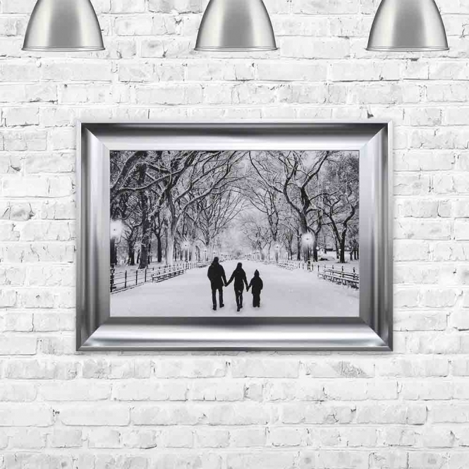 COUPLE AND CHILD ENJOYING A WINTER WALK FRAMED WALL ART