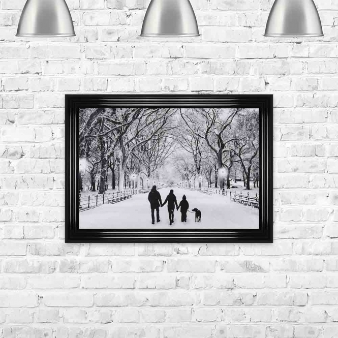 COUPLE WITH CHILD AND DOG ENJOYING A WINTER WALK FRAMED WALL ART