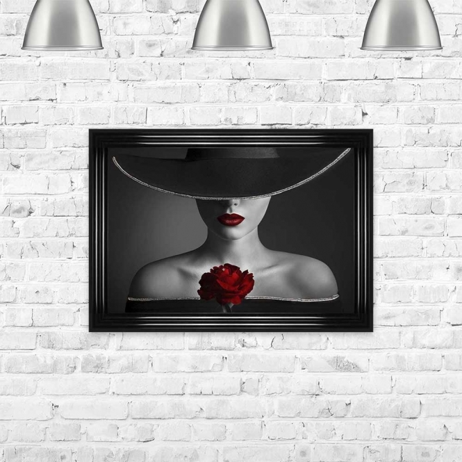 ELEGANT WOMAN HOLDING A SINGLE RED ROSE FRAMED WALL ART