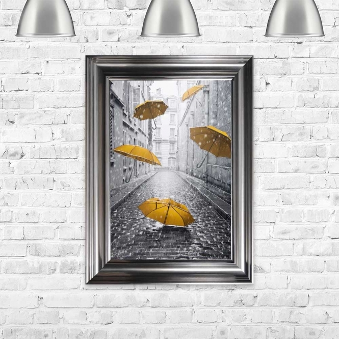 YELLOW UMBRELLAS ON THE STREETS OF PARIS FRAMED WALL ART